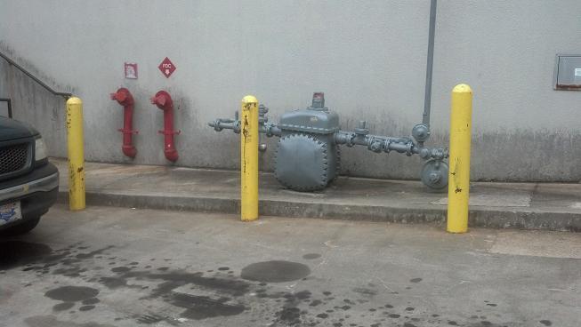 Atlanta Pipe Bollards Cemented In Place- H & A Enterprises Inc